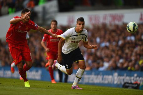 Lamela is held back by Lovren