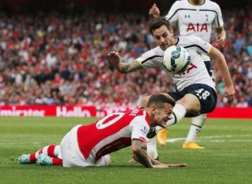 Ryan Mason kicks Wilshere